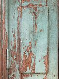 Old wooden door with shabby turquoise paint. Part of the old wooden door with shabby turquoise paint royalty free stock photos