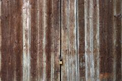 Old Wooden Door with Lock. Old Wooden Door of Shed with Lock Royalty Free Stock Image