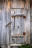 Old wooden door. Small housing old wooden door locked stock image