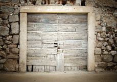 Old wooden door in stone house Royalty Free Stock Images