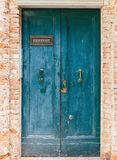 Old wooden door in a stone house. Italian stock images