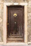 Old wooden door. In a stone house Italian stock photography