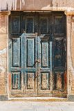 Old wooden door. In a stone house Italian royalty free stock photography