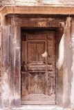 Old wooden door. In a stone house Italian royalty free stock image