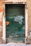 Old wooden door. In a stone house Italian stock image