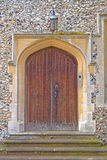 Old wooden door with stone surround Royalty Free Stock Image