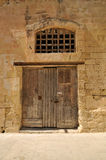 Old wooden door in a stone wall Stock Photo