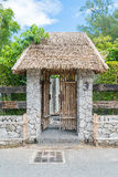 An old wooden door. With stone wall Stock Image