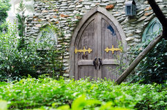 Old wooden door with stone wall Stock Photos