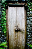Old wooden door in a stone wall Royalty Free Stock Images