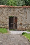 Old wooden door in stone wall Stock Images