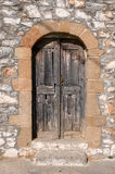 Old wooden door in the stone wall Stock Image