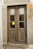 Old wooden door in stone wall Royalty Free Stock Image