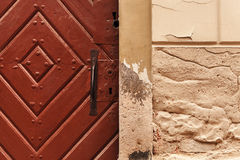 Old wooden door and stone wall texture Stock Photography