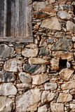Old wooden door on a stoned wall Royalty Free Stock Image