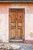 Old wooden door with stones, architecture detail Stock Image