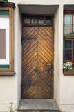 Old wooden door on a street facade Stock Images