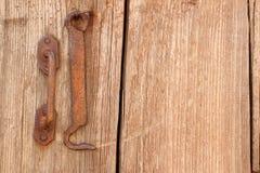 Old wooden door texture. Old wooden door and metal hook Royalty Free Stock Photography