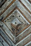 Old wooden door with textured pattern stock image