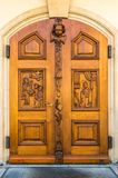 Old wooden door to the church in St. Gallen Stock Photography