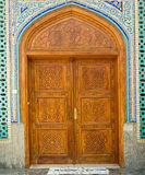 Old wooden door to the mosque, hand-crafted. Ali bin Abi Taleb Mosque. Traditional arabic cargo boats at Dubai creek Royalty Free Stock Image