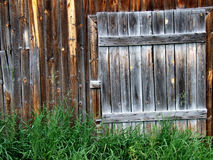 Old wooden door to a shed. Old wooden door - entrance to a barn Royalty Free Stock Photos
