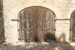 Old wooden door in two gates. Old wooden door in two gates in the fortress Royalty Free Stock Photo