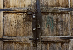 Old wooden door with two lock of keys Royalty Free Stock Photography