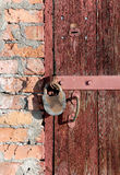 Old wooden door with two locks Royalty Free Stock Photography