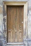 Old wooden door. Old urban wooden entrance door Royalty Free Stock Images