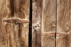Old wooden door used in the village. Rural, natural old wooden door Stock Photos