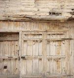 Old wooden door used in the village. Rural, natural old wooden door Stock Photo