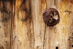 Old wooden door used in the village. Rural, natural old wooden door Royalty Free Stock Images