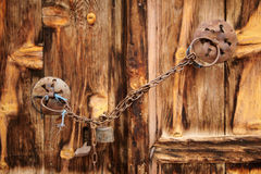Old wooden door used in the village. Rural, natural old wooden door Royalty Free Stock Image