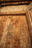 Old wooden door used in the village. Rural, natural old wooden door Royalty Free Stock Photos