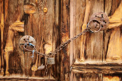 Old wooden door used in the village. Rural, natural old wooden door Stock Images