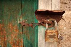 Old wooden door used in the village. Rural, natural old wooden door Royalty Free Stock Photo