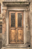 Old wooden door in Venice, Italy Royalty Free Stock Image