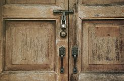 Old wooden Door, vintage style. Old wooden locked door with ornaments, Secret and Mystic Concept royalty free stock photos