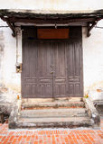 Old wooden door. And old wall Royalty Free Stock Photo