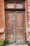 Old wooden door in the wall Royalty Free Stock Images