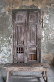 Old wooden door in the wall of old building. Stock Photo