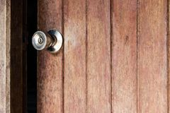 Old wooden door was ajar. And a stainless steel door knob disintegrated Royalty Free Stock Photography