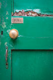 Old wooden door with weathered green paint Stock Photos