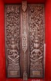Old wooden door were carved Thai pattern Stock Photos