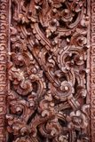 Old wooden door were carved Thai pattern Stock Photography