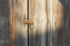 Old wooden door which has old lock at old town. Songkhla province Thailand Royalty Free Stock Image