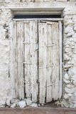 White door. Is an old wooden door white and abandoned royalty free stock photos