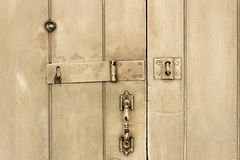 Old wooden door. White handle, lock, eye hole Stock Photo
