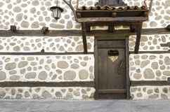 Old wooden door and White stone wall Stock Images